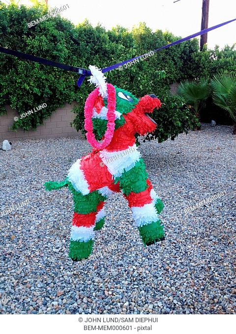Colorful pinata on string outdoors