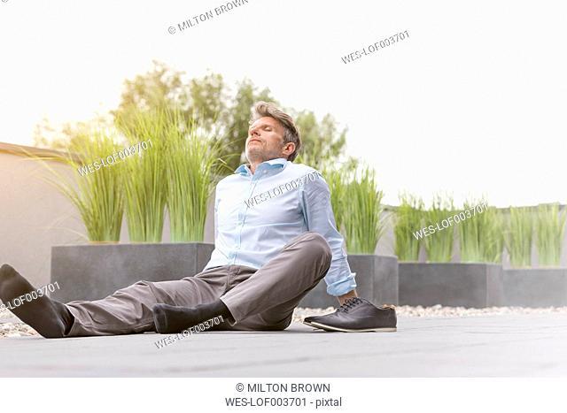 Mature man taking a break on rooftop terrace
