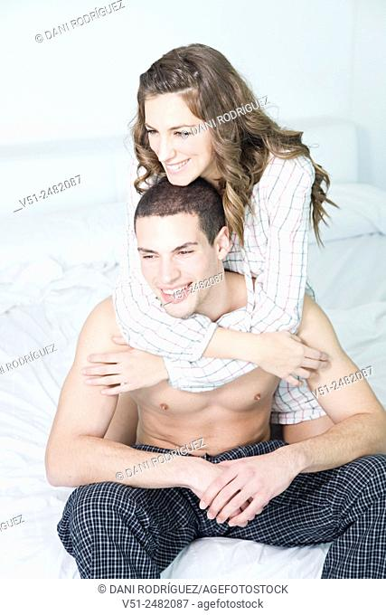 Portrait of a beautiful couple in bed