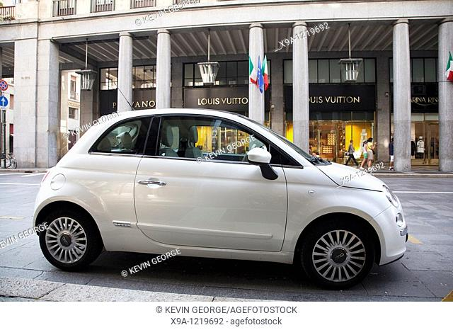 Fiat 500 car outside Louis Vuitton Shop in Via Roma Street in Turin, Italy