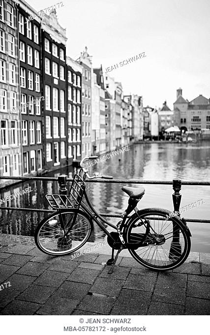 A bicycle and the canal houses of Amsterdam