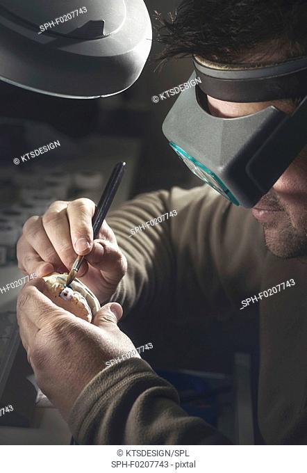 Man working on dental prosthesis