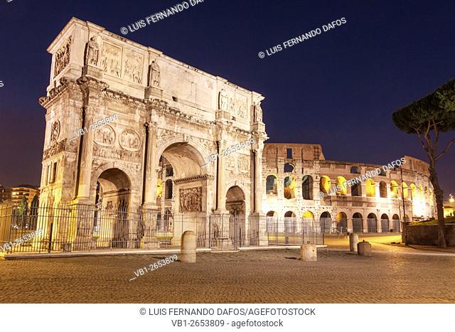 Arch of Constantine and Coliseum illuminated by night. Rome, Italy