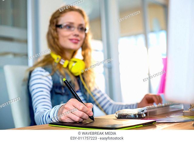 Smiling designer working with digitizer