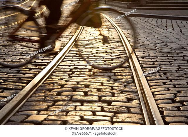 Tram track with cyclist in Ghent, Belgium