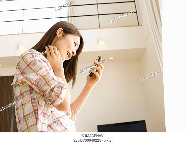 Middle-aged woman using a smartphone