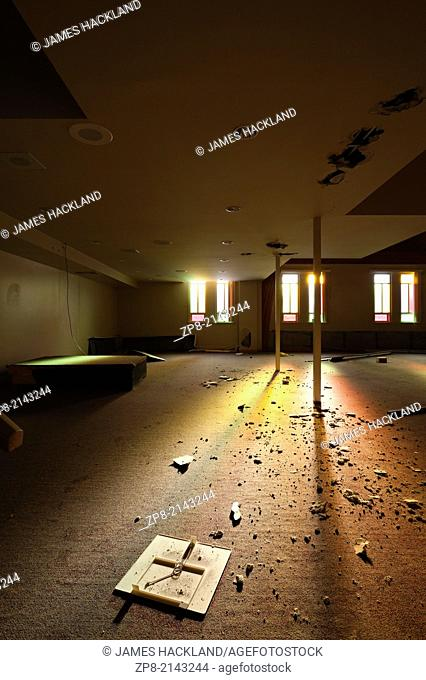 A plastic cover that resembles a cross in an abandoned church. Harvest Bible Church, Oakville, Ontario, Canada. This Church has been demolished so there is no...