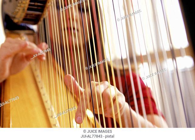 Woman playing a harp in Munich
