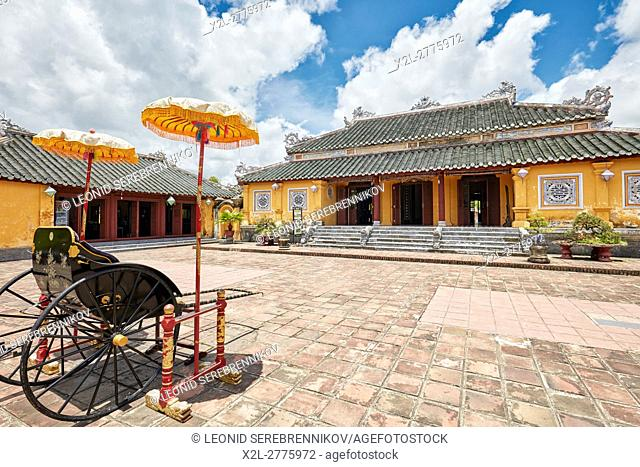 Traditional rickshaw carriage at Truong Sanh Palace. Imperial City (The Citadel), Hue, Vietnam