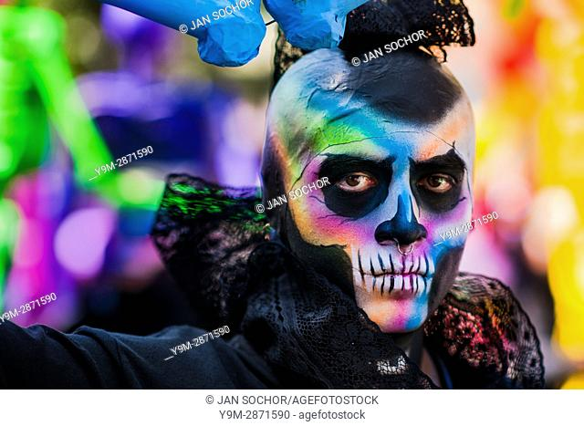 A Mexican man, having his face colorfully painted with skull, takes part in the Day of the Dead parade in Mexico City, Mexico, 29 November 2016