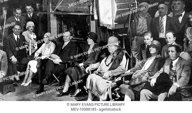 A visit of a former US President to Hollywood; Calvin Coolidge on Mary Pickford's set. The famous actress is on his right