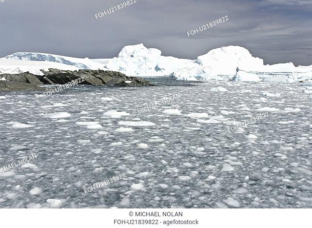 Huge icebergs and brash ice near Petermann Island on the west side of the Antarctic Peninsula