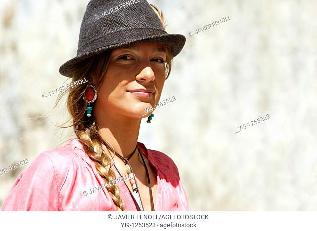 Happy young woman portrait with grey hat