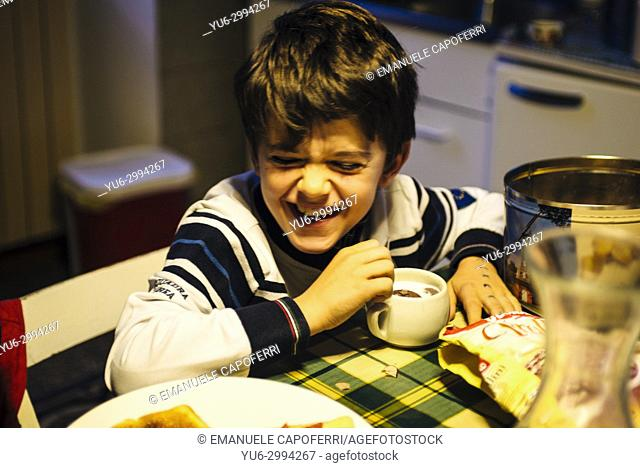 baby laughs while having breakfast