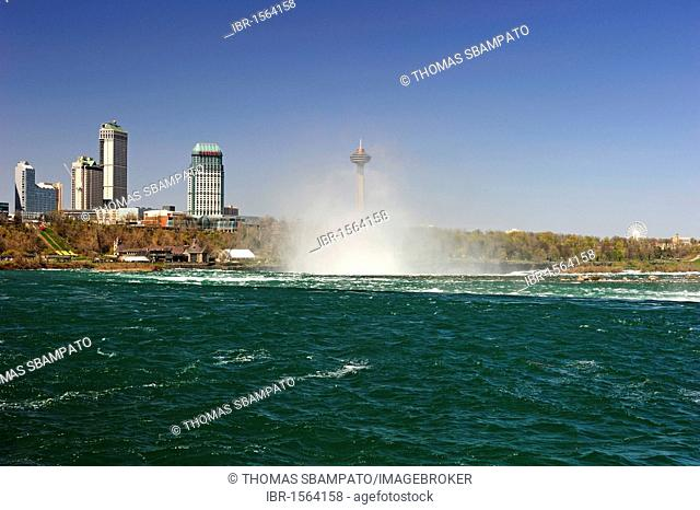 Niagara Falls with the adjacent hotels overlooking the falls on the Canadian side, Ontario, Canada