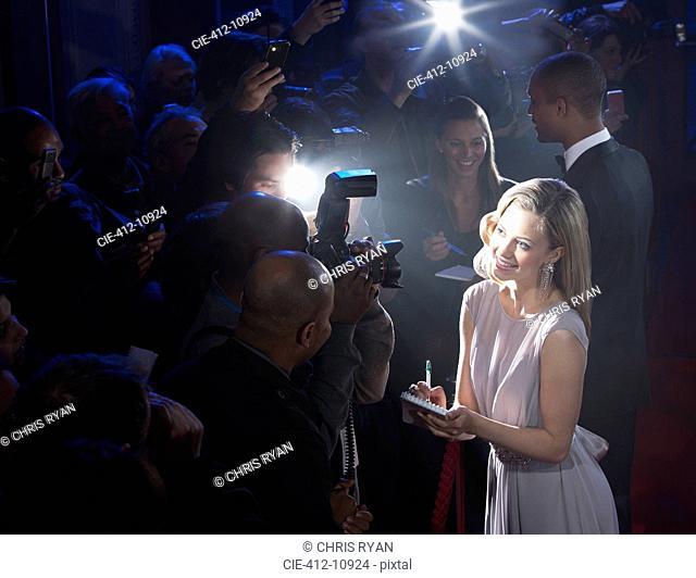 Female celebrity signing autographs