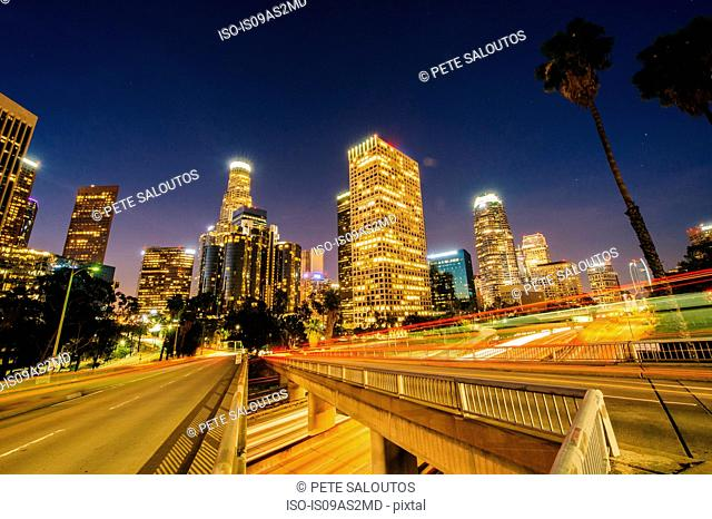View of city skyscrapers and highway at night, Los Angeles, California, USA