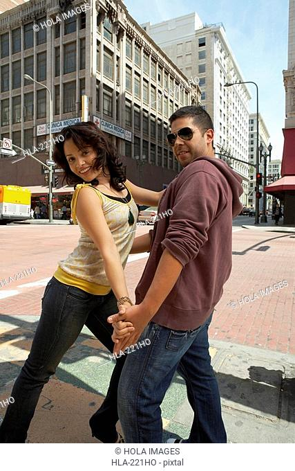 Young couple salsa dancing on the road