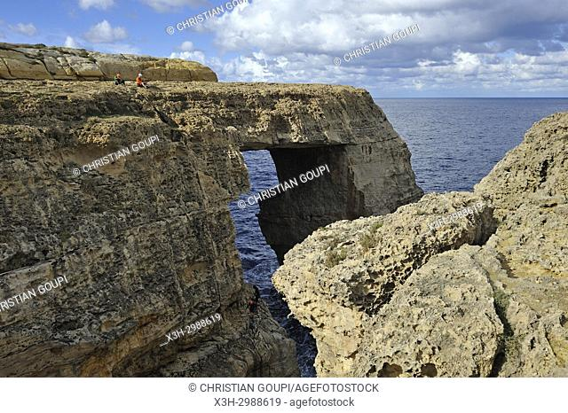 climbers at Wied Il-Mielah a limestone natural arch on the northwest coast of Gozo Island, Malta, Mediterranean Sea, Southern Europe