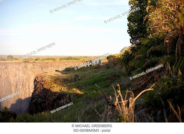 Tourists on cliff top, Victoria Falls, Zimbabwe