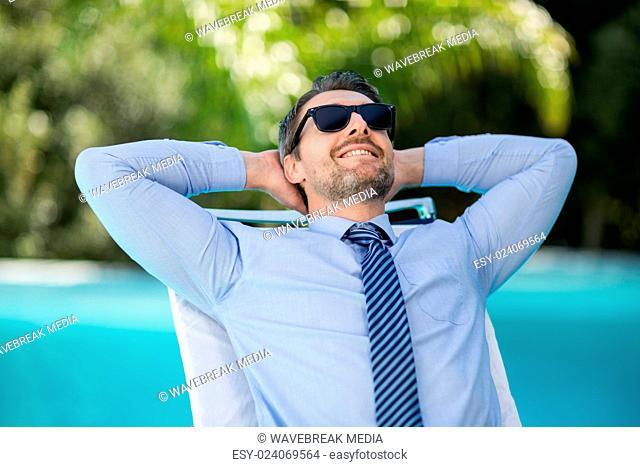 Smart man relaxing on sun lounger