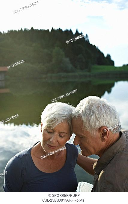 Senior couple lying heads to each other