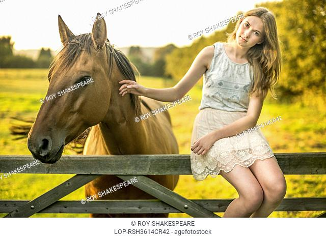 England, Kent, Chartham. A 15 year old girl with a horse
