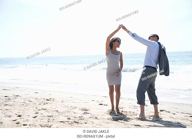 Couple walking and enjoying beach