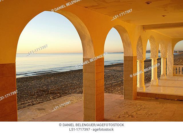 arch of houses at Santa Pola beach, Salinas de Santa Pola Nature Reserve, Santa Pola, Alicante, Spain