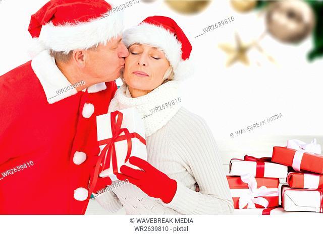 Man kissing woman on cheeks