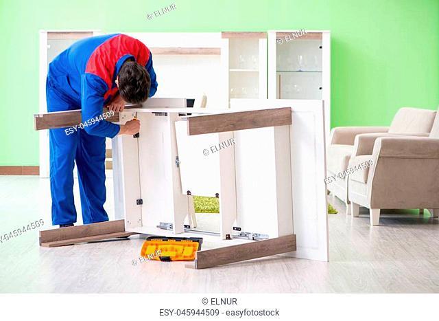 Repair contractor repairing broken furniture at home