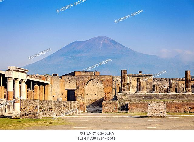 Old ruins and mount Vesuvius in background