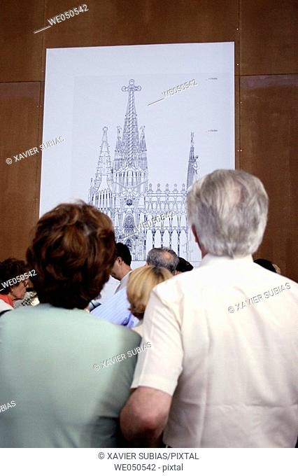 People looking at blueprint of the Sagrada Familia temple by Gaudí, Barcelona. Catalonia, Spain