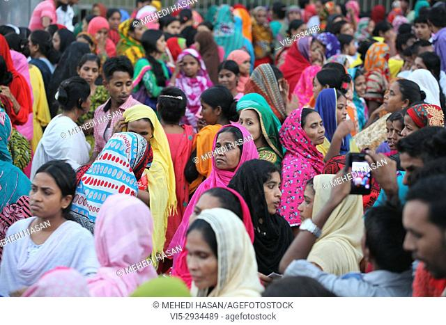 Bangladeshi garments workers attend a demonstration protest for their due salary and wages in front of National Press Club in Dhaka