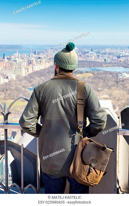 Tourist enjoying in New York City panoramic view . Central park seen from observation deck