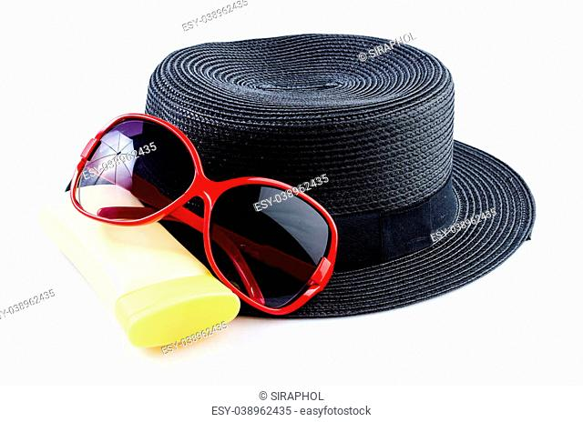 Beach accessories , sunglasses , vintage women hat , body lotion , on isolated white background