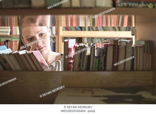 Female student searching books in the library