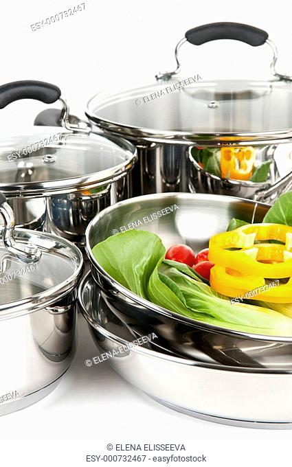 Stainless steel pots and pans with veget