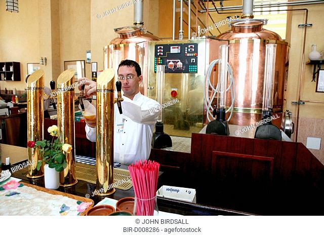 Pouring beer brewed on the premises at Taberna de la Muralla, Plaza Vieja, Havana, Cuba