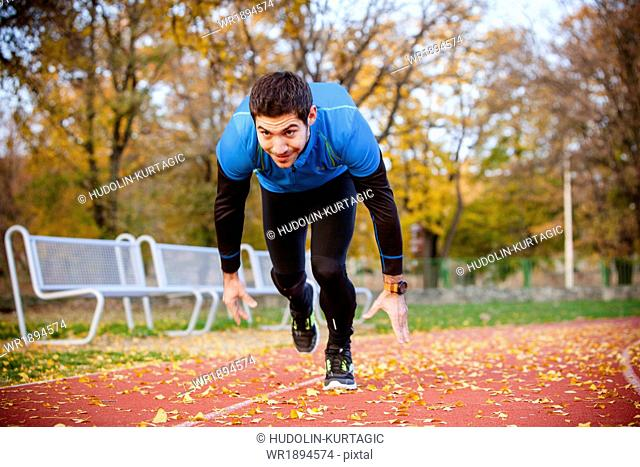 Male runner doing sprint training