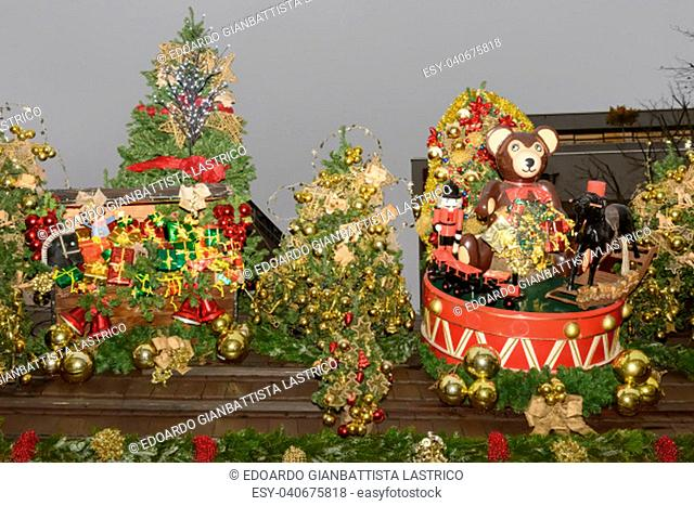 STUTTGART, GERMANY - DEC 02: gift wraps, toys and decorated spruce on stall roof at traditional Christmas market hold in city center, shot on dec 02 2014