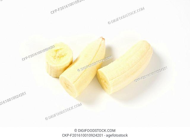 three pieces of peeled banana on white background
