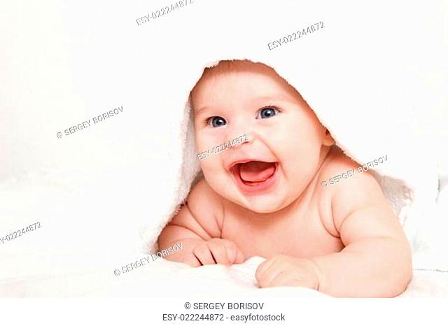 Laughing baby with towel