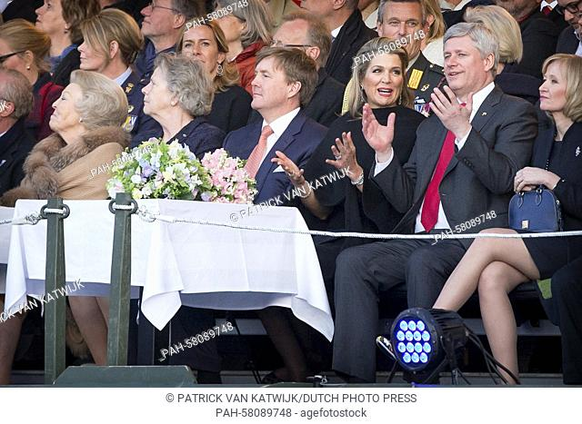 King Willem-Alexander (C), Queen Maxima (3rd R) and Princess Beatrix (L) of The Netherlands and Canadian Prime Minister Stephen Harper (2nd R) and his wife...