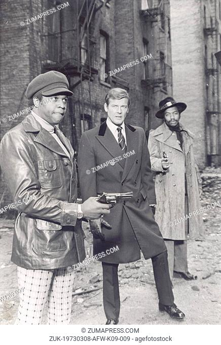Mar. 8, 1973 - London, England, U.K. - Actor ROGER MOORE acting with his co-stars on the set of his current James Bond film