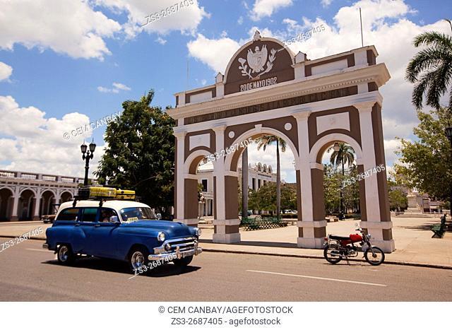Old American car in front of the Triumphal Arch-Arco de Triunfo at Parque Jose Marti Park, Cienfuegos, Cuba, Central America