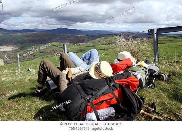 pilgrims resting on the Camino de Santiago before reaching Triacastela (Lugo)
