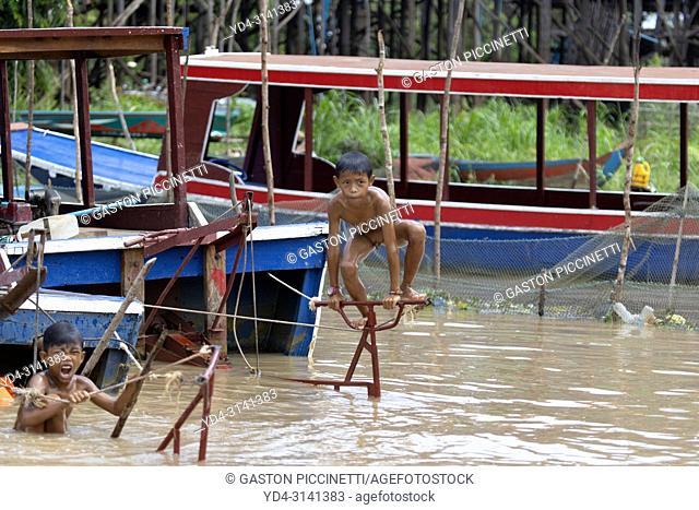 Children bathing in the lake , floating village of Kompong Phluk, Siem reap Province, Kingdon of Cambodia. Kompong Phluk
