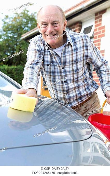Portrait Of Senior Man Washing Car