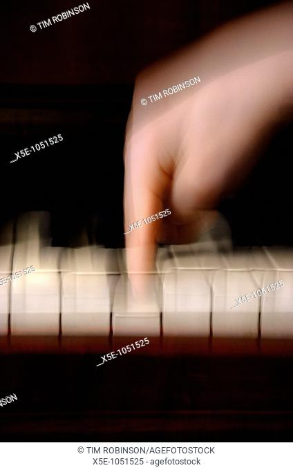 Finger playing piano key